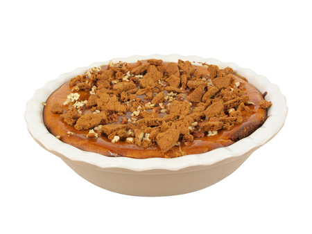 isolated photo of a homemade pumpkin and caramel cheesecake topped with walnuts and crushed ginger bread cookies Stock fotó - 48450717