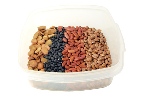 pinto beans: a assortment of dried fava beans, kidney beans, black beans and pinto beans in a container
