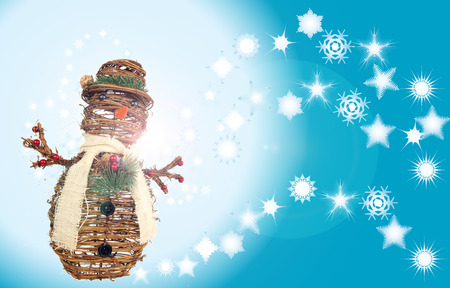 xmas holiday background of stylized diverse snowflakes and snowman ornament made of twigs for layouts requiring winter scenery