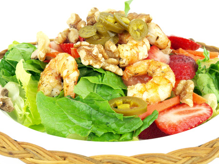 healthy salad of shrimp, lettuce, tomato. onion, pepper, walnuts and jalapeno on a white background Stok Fotoğraf