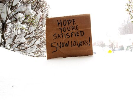 directed: cardboard sign directed to snowlovers during a blizzard in the winter of 2016