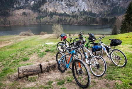 manage transportation: Bicycles parked near a mountain lake Stock Photo