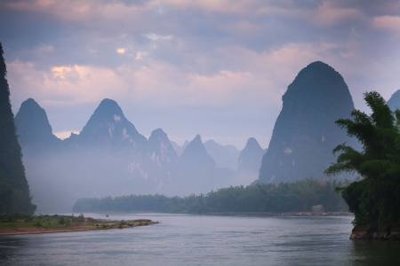 guilin: karst mountain landscape and reflection in yangshuo, guilin,