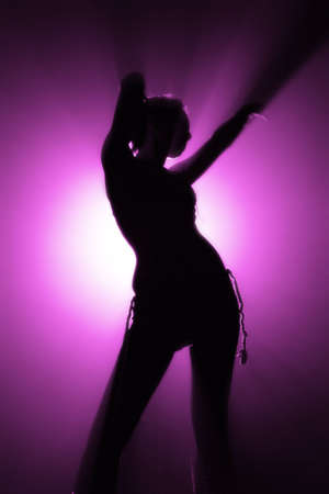 shape [silhouette] of disco dancer in pink color