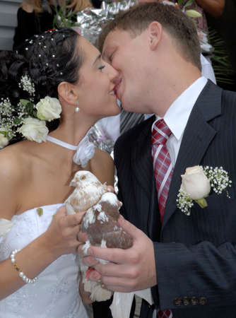 fiance: kissing  married couple with doves Stock Photo