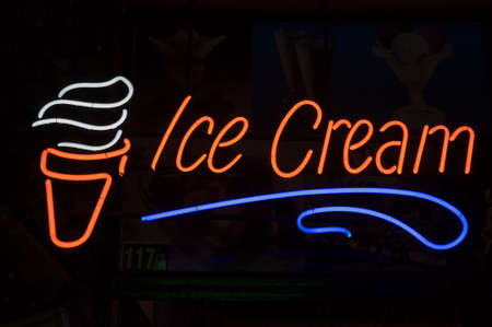 ice-cream neon lable and sign isolated on black photo