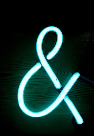 close up of neon ampersand sign photo