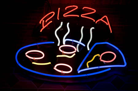 neon pizza sign in the night photo