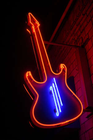 red neon guitar with blue strings Stock Photo