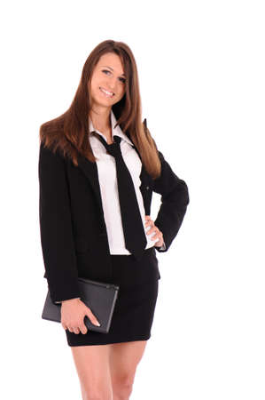 skirt suit: glad businesswoman with small black laptop isolated on white