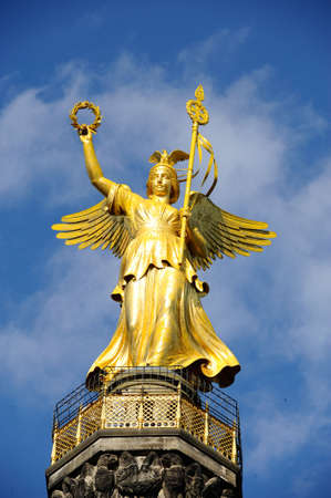 golden statue in Berlin, Germany photo