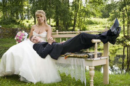 the newly married couple resting in the park photo