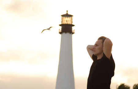 free thought: meditative man and lighthouse in Miami, Florida Stock Photo
