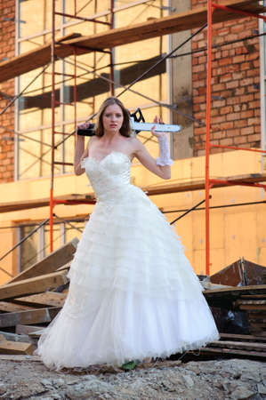 exasperate: bride in white dress with saw