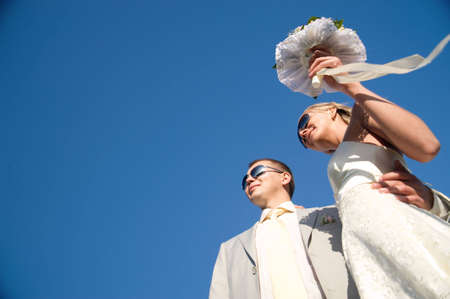 wedding day of young pair. isolated on blue sky photo