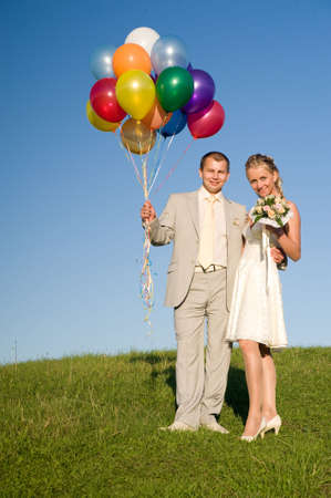 wedding pair in the field. good mood picture. may be use for wedding cards and posters photo