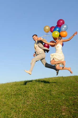 flight of young and happy wedding pair. good use for loving concept photo