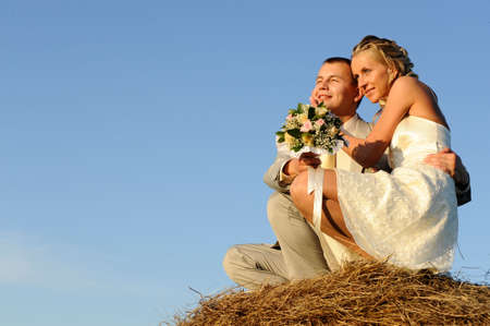 young wedding pair on mow photo