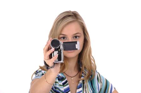 HD ビデオカメラで若いきれいな女性