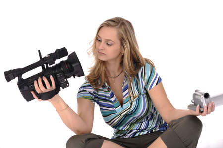 Young pretty woman with professional and amateur videocameras photo