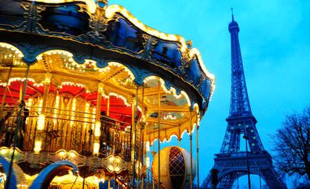 carousel near Eiffel tower in Paris photo