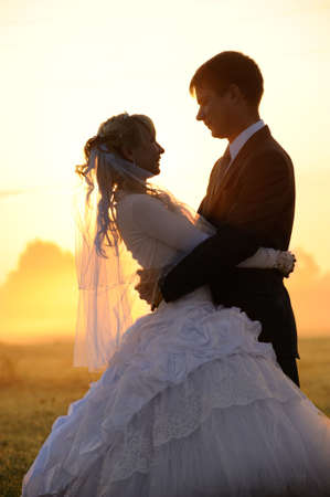 silhouette of young wedding pair photo