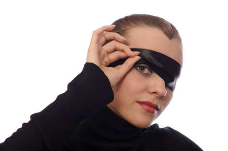 playful beauty woman with black ribbon on eye isolated on white photo