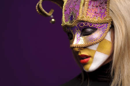 profile of pretty woman closed eyes in violet half-mask