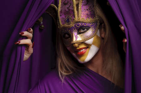 smiling woman in violet mask open curtain, may be use for theater concept