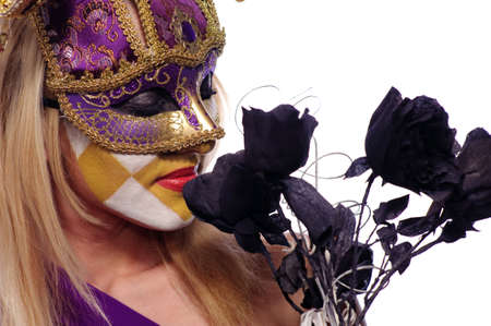 pretty young woman in violet mask sniff black roses, isolated on white, may be use for Venice concept Stock Photo - 7827483