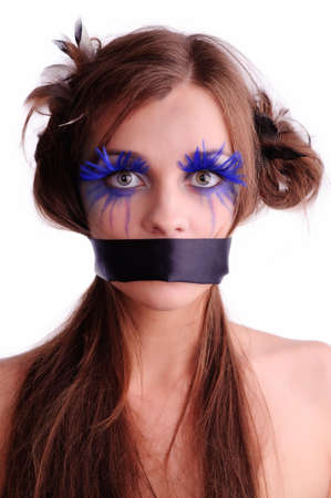 sexy woman with fashion make-up and black ribbon on the mouth, isolate on white. may be use for brutal treatment concept photo