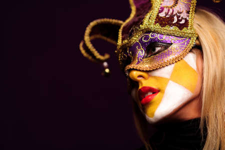 closeup portrait of sexy woman in violet party mask. good use for desire concept photo