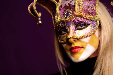 erotic fantasy: young sexy woman in violet party half mask. may be use for fashion makeup concept Stock Photo