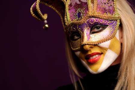 young sexy woman in violet party half mask. may be use for fashion makeup concept Stock Photo