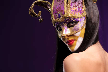 woman in violet half mask, good use for carnival concept photo