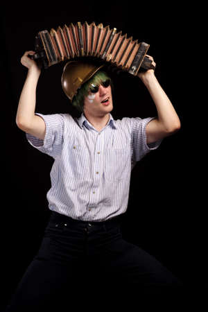 harmonist: crazy harmonist made stun by accordion, isolated on black. may be use for safety engineering concept
