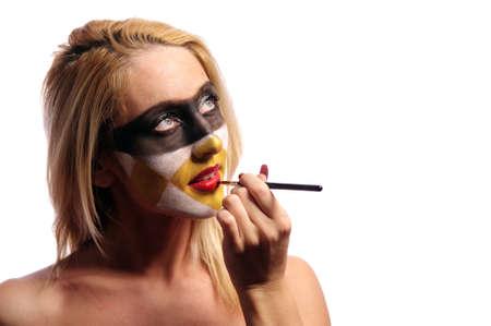 beautiful blonde woman doing fashion make-up, isolated on white, may be use like pilferer concept photo
