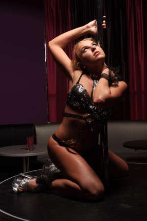 sexy danser wait near pole in nightclub Stock Photo