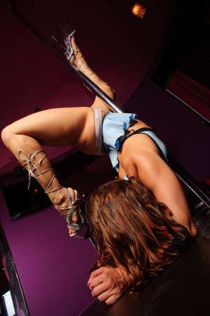 sexy dancer near pole in nightclub Stock Photo - 8183462