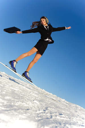 happy jumping businesswoman go skiing photo