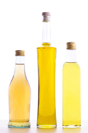closed bottles of olive oil and bottle of wine vinegar isolated on white Stock Photo