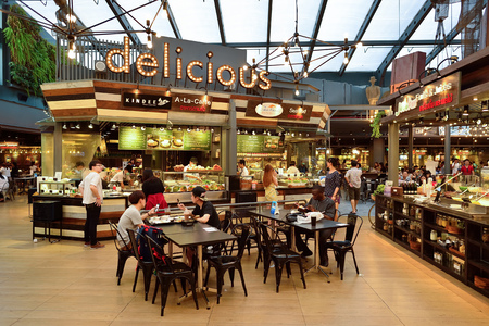 BANGKOK, THAILAND - JUNE 20, 2015: Siam food court interior. There are a lot of cafes and restaurants in shopping malls and department stores of Bangkok