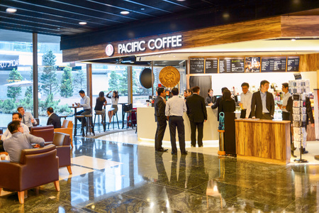 HONG KONG, CHINA - MAY 05, 2015: Pacific Coffee cafe interior. Pacific Coffee Company is a Pacific Northwest U.S.- style coffee shop group originating from Hong Kong, with a few outlets in China, Singapore and Malaysia Editorial