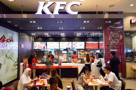 BANGKOK, THAILAND - JUNE 21, 2015: KFC restaurant interior. KFC is a fast food restaurant chain that specializes in fried chicken and is headquartered in Louisville, Kentucky, in the United States Sajtókép