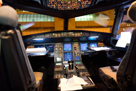 ROME, ITALY - AUGUST 04, 2015: Airbus A320 cockpit interior at night. The Airbus A320 family consists of short- to medium-range, narrow-body, commercial passenger twin-engine jet airliners manufactured by Airbus