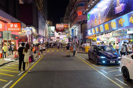 HONG KONG - JUNE 01, 2015: Mongkok area. Mong Kok is characterized by a mixture of old and new multi-story buildings, with shops and restaurants at street level and commercial or residential units above.