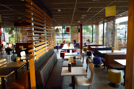 ORLEANS, FRANCE - AUGUST 12, 2015: McDonald's restaurant interior. McDonald's is the world's largest chain of hamburger fast food restaurants, founded in the United States.