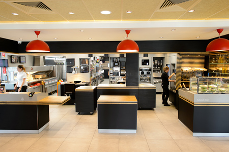 LA VILLE-AUX-DAMES, FRANCE - AUGUST 12, 2015: McDonalds restaurant interior. McDonalds is the worlds largest chain of hamburger fast food restaurants, founded in the United States.