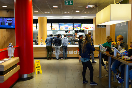 PRAGUE, CZECK REPUBLIC - AUGUST 18, 2015: McDonald's restaurant. McDonald's is the world's largest chain of hamburger fast food restaurants, founded in the United States.