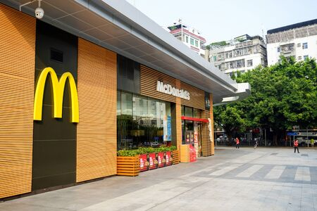 SHENZHEN, CHINA - OCTOBER 09, 2015: McDonalds restaurant exterior. McDonalds primarily sells hamburgers, cheeseburgers, chicken, french fries, breakfast items, soft drinks, milkshakes, and desserts